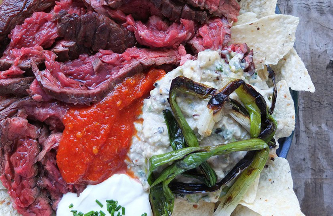 Smoky steak and spring onion nachos